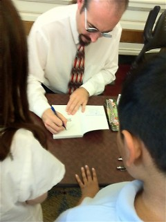 GAAH Press Club gets their books signed by Michigan author Johnathan Rand.