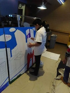 A Kids Summit attendee paints the Grand Rapids skyline.