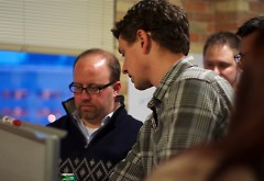 One of Startup Weekend's organizer, Aaron Schaap, right, talks with a team about their business idea at a previous year's event.