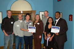 """The Design Team from Steelcase and Well House staff and residents pose with their """"Do More"""" awards."""