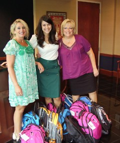 Members of the Marilyn J. Olson Guild and D.A. Blodgett staff pose with newly stuffed backpacks.