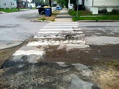 Even before harsh winter weather, Grand Rapids streets, such as Baldwin in East Hills, show substantial deterioration.
