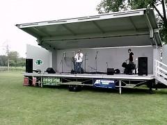 Mark Sala band leader gets stage ready for concert.