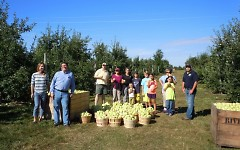 Volunteers and Feeding America West Michigan staff teamed up to gather nearly 600 pounds of apples at Riveridge.