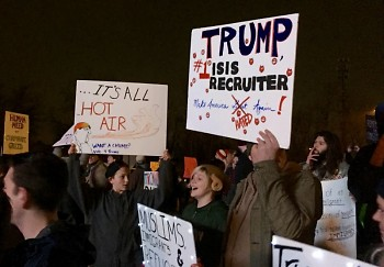 Protestors chant anti-bigotry message at Trump rally