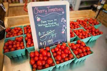 Nourish Organic Market displays tomatoes from Vertical Paradise Farms