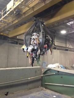 "Covanta's crane, the ""claw"", loading garbage at the incinerator"