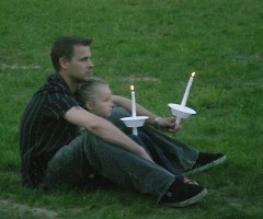 A man and his daughter sit close to each other for the entire vigil
