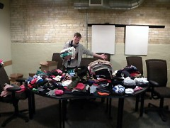 @Teresa Z helps organize the winter supplies that Spectrum Health delivered!