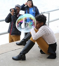 Zakia, another WMCAT teenage student, demonstrating her passion for photography.