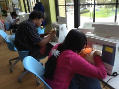 WMCAT fashion design students working on exhibit projects.