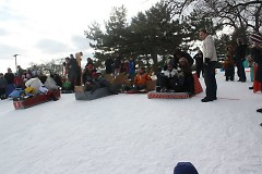 start of the WinterWest Crazy Cardboard Sled Race