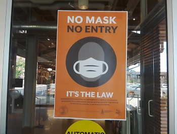 """No mask, no entry"" sign at entrance of Downtown Market Grand Rapids."
