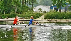 Grand Rapids Crew members train for fall regattas in a double rowing shell just off the shore of the GR Rowing Association