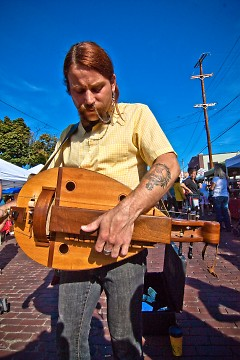 Jesse Macintosh plays his hurdy gurdy on the Wealthy Street during Eastown Street fair 2009