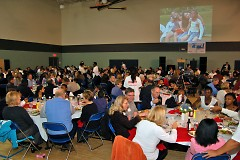 Over 240 sponsors/guests and 120 Club members enjoying dinner together while watching a presentation featuring our youth.